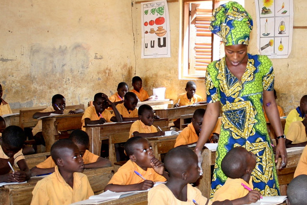 Teacher with class in Ghana